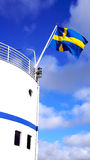 Ship and Sweden's flag in Stockholm Royalty Free Stock Images