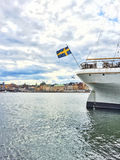 Ship with Swedish flag and view over Gamla Stan, Stockholm Stock Photography