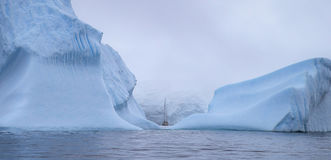 The ship swims between the huge icebergs. Andreev. stock images