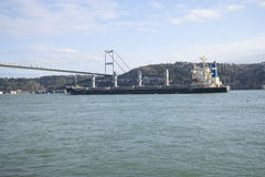 The ship swims up to the Bosphorus bridge. Istanbul Stock Images