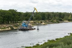 The ship of the technical fleet cleans the river Sozh Belarus, Royalty Free Stock Images
