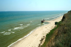 The ship thrown out at coast of the black sea Stock Photos