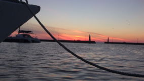 Ship tied in harbor during sunrise. Ship tied in sea harbor during sunrise stock video