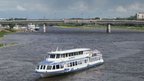 Ship with tourists floating on river in Russia. VELIKIY NOVGOROD, RUSSIA - JUNE 22, 2017: Panoramic view of ship with tourists floating on the Volkhov river in stock footage