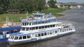 Ship with tourists floating on river in Russia. VELIKIY NOVGOROD, RUSSIA - JUNE 22, 2017: Panoramic view of ship with tourists floating on the Volkhov river to stock video