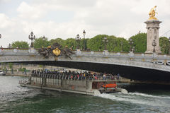 Ship with tourists floats under the bridge of Alexander lll. Paris,France- April 29, 2017: Ship with tourists floats under the bridge of Alexander lll Stock Images