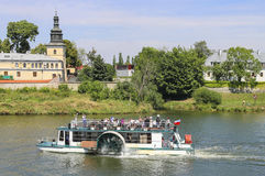 Ship with tourists at the Wisla river in Krakow, Poland. Stock Photos