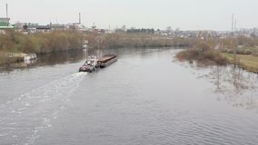 Ship tows a barge on the river. The view from the top. Hd stock video footage