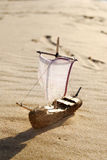 Ship toy model. On the beach stock images