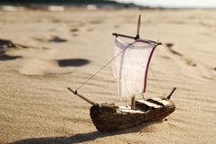 Ship toy model. On the beach stock photography