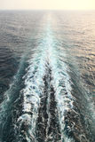 Ship trail with waves and foam in ocean Stock Photos