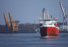 Ship transport cargo. Red ship, transport, cargo Szczecin - Swinoujscie harbour royalty free stock photo