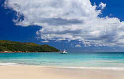 Ship on tropical beach stock photography