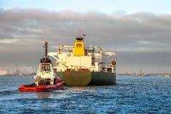 Ship with tug Royalty Free Stock Image