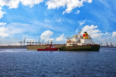 Ship and tugboat Stock Images