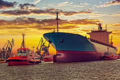 Ship with tugs Stock Photography