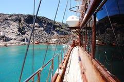 Ship on turquoise water. (Santorini island, Greece royalty free stock image