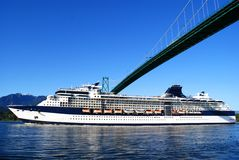 Ship under bridge. A cruise ship under a suspension bridge stock photography