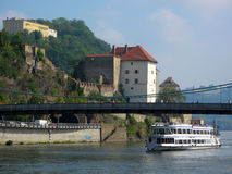 Ship under bridge on Danube river Stock Photo