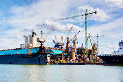 Ship under construction, repair. Industrial in shipyard Stock Image