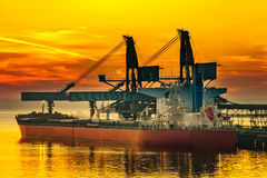 Ship under loading. Big ship under loading coal in Port of Gdansk, Poland Royalty Free Stock Photography
