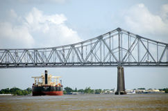Ship under New Orleans bridge Royalty Free Stock Image