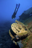 Ship underwater with diver. A scuba diver is exploring sunken ship in deep water Royalty Free Stock Images