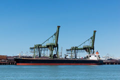 Ship is unloading the iron ore Royalty Free Stock Photos