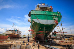 Ship waiting for repairs on a dry dock.  Stock Images