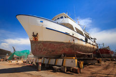 Ship waiting for repairs on a dry dock.  Stock Image