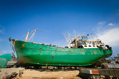 Ship waiting for repairs on a dry dock. Outdoor Royalty Free Stock Photography