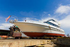 Ship waiting for repairs on a dry dock Stock Image
