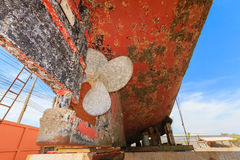 Ship waiting for repairs on a dry dock ,Two-blade propeller. Made ​​of brass on the stocks Stock Images