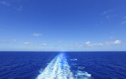 Ship wake in blue ocean. Ship wake in beautiful blue ocean against sky Royalty Free Stock Photo