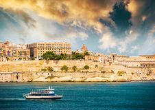 Ship on the way to Valletta. Lonely ship on the way to Valletta port in Malta at sunset Royalty Free Stock Photos