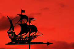 Ship Weather Vane against a Red Sky at Sunset Royalty Free Stock Photo
