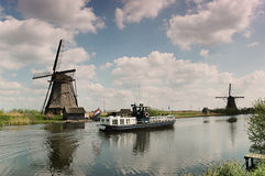 Ship between the windmills royalty free stock image