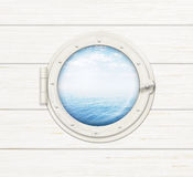 Ship window or porthole on white wooden wall Stock Photos