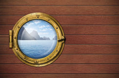 Ship window with sea or ocean with tropical island Stock Photo