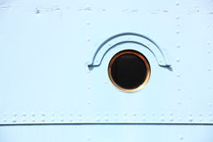 Ship window steel blue background Stock Photo