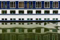 Ship windows with their reflections in water. Stock Photo