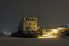 Ship wintering  in night river port Royalty Free Stock Image