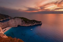 Ship Wreck beach and Navagio bay at sunset. The most famous natural landmark of Zakynthos, Greek island in the Ionian Sea. Ship Wreck beach and Navagio bay at stock photography