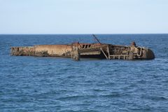 Ship wreck by the city stock images