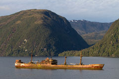 Ship wreck in a fjord of Patagonia Stock Photos