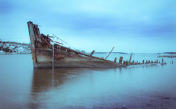 Ship wreck in a frozen fjord Royalty Free Stock Image