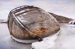 Ship-wreck in ice. An old wooden ship halfway sunken in an ice covered archipelago. Halleviksstrand, Orust, Bohuslan, Sweden stock photo