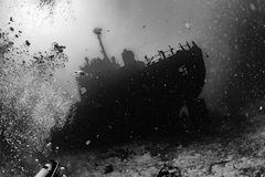 Ship Wreck in maldives indian ocean. Ship Wreck silhouette underwater while diving stock images