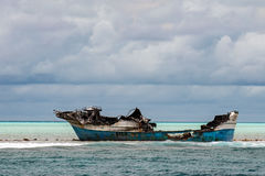 Ship wreck on the reef Royalty Free Stock Photos