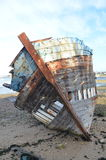Ship wreck rotting on the beach Royalty Free Stock Image